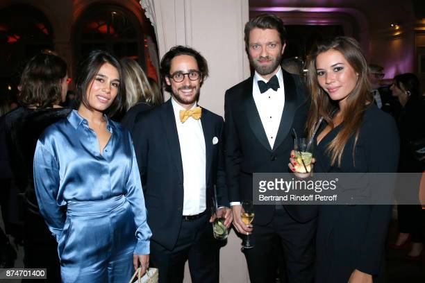 Thomas Hollande his companion Emilie Broussouwoux Emilie Tran Nguyen and Antoine Genton attend the GQ Men of the Year Awards 2017 at Le Trianon on...