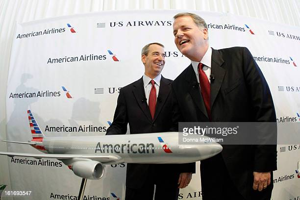 Thomas Horton Chairman President and Chief Executive Officer of American Airlines and Doug Parker Chairman and CEO of US Airways pose with a model...