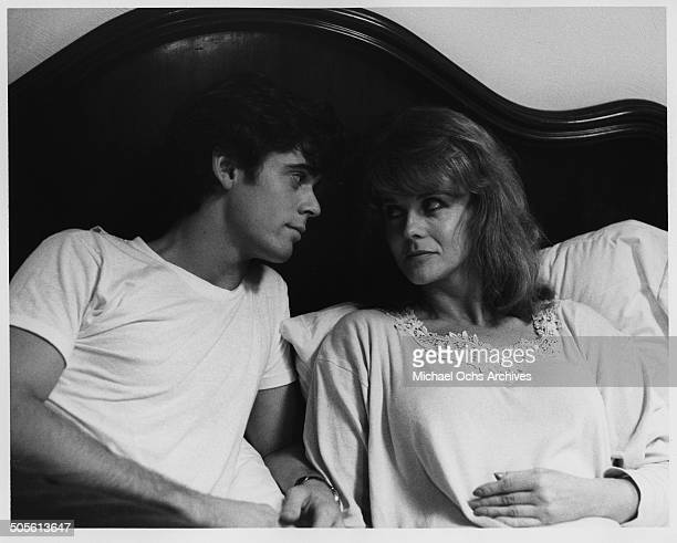 Thomas Howell lays in bed with AnnMargret in a scene from the movie A Tiger's Tale circa 1987