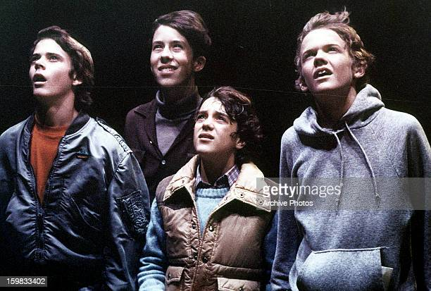 C Thomas Howell Sean Frye KC Martel Robert MacNaughton looking up in a scene from the film 'ET The ExtraTerrestrial' 1982