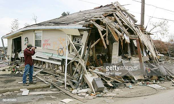 Thomas Hudson of Arkansas, a photography student at Marlboro College in Vermont, takes a photo of a destroyed house in the heavily damaged Lower...