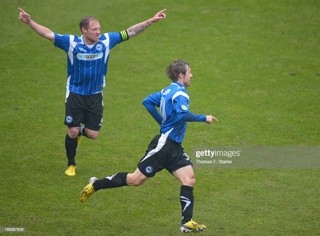 Thomas Huebener (L) and Sebastian Hille of Bielefeld celebrate their team's first goal during the Third League match between Arminia Bielefeld and Preussen Muenster at Schueco Arena on March 9, 2013 in Bielefeld, Germany.