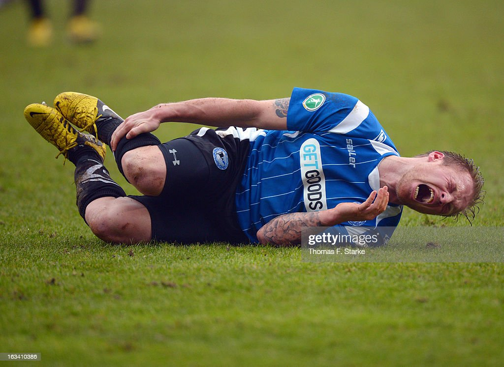 Thomas Huebener of Bielefeld squalls in pain during the Third League match between Arminia Bielefeld and Preussen Muenster at Schueco Arena on March 9, 2013 in Bielefeld, Germany.