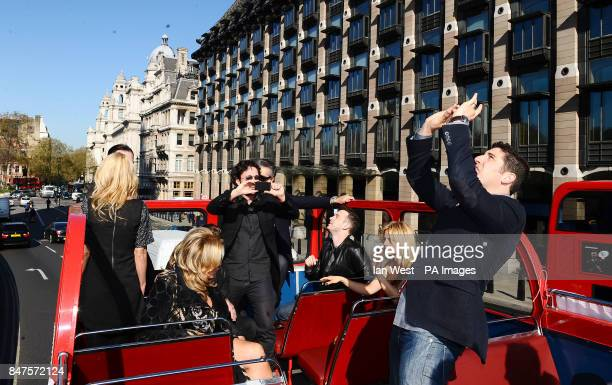 Thomas Ian Nicholas and Jason Biggs take photos while on an open top bus to promote his new film American PieReunion in London
