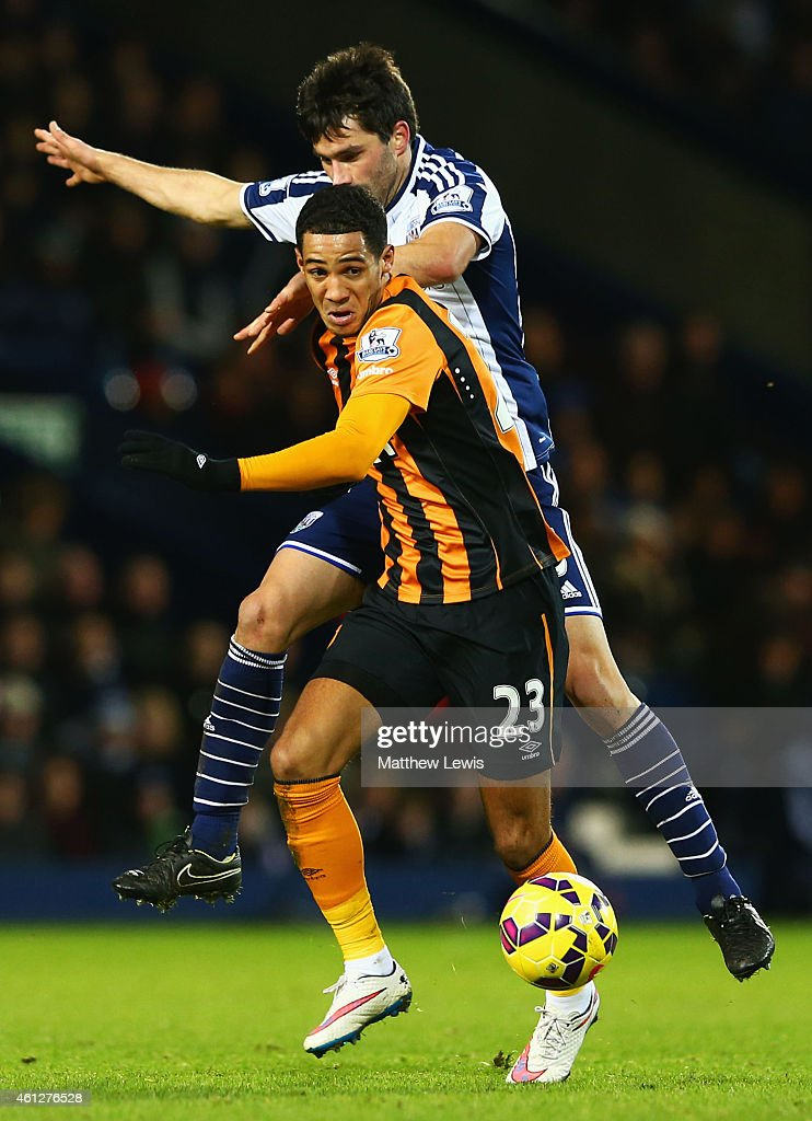 Thomas Ince of Hull City holds off Claudio Yacob of West Bromwich Albion during the Barclays Premier League match between West Bromwich Albion and Hull City at The Hawthorns on January 10, 2015 in West Bromwich, England.