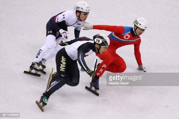 Thomas Insuk Hong of the United States Keita Watanabe of Japan and Kwang Bom Jong of North Korea during the Men's Short Track Speed Skating 500m...