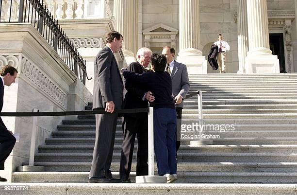 Thomas J Bliley Jr RVa and Anna G Eshoo DCalif hug and say goodby on the House Chamber steps after the last vote before recess