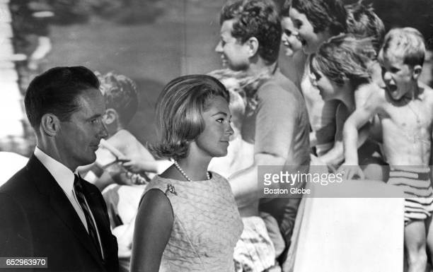 Thomas J White leading the Kennedy Library Fund drive in New England and Mrs Joan Kennedy stand before a huge picture of John F Kennedy at the...