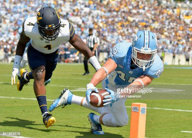 Thomas Jackson of the North Carolina Tar Heels stretches across the goal line for a touchdown as Derron Brown of the California Golden Bears defends...