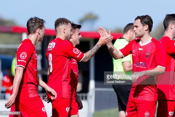 Thomas James of the Wollongong Wolves celebrates after scoring with teammates during the National Premier League Semi Final between Wollongong Wolves...