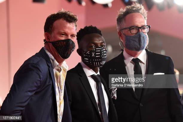 """Thomas Jane, Olly Sholotan and Director Kyle Rankin walk the red carpet ahead of the movie """"Run Hide Fight"""" at the 77th Venice Film Festival on..."""