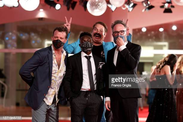 """Thomas Jane, Olly Sholotan , Director Kyle Rankin and Joel Michaely walk the red carpet ahead of the movie """"Run Hide Fight"""" at the 77th Venice Film..."""