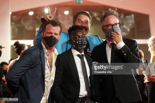 """Thomas Jane, Olly Sholotan, Joel Michaely and Director Kyle Rankin walk the red carpet ahead of the movie """"Run Hide Fight"""" at the 77th Venice Film..."""