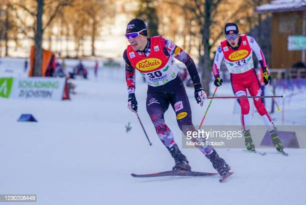 Thomas Joebstl of Austria and Espen Andersen of Norway competes during the Men's Gundersen Normal Hill HS98/10.0 Km at the FIS Nordic Combined World...