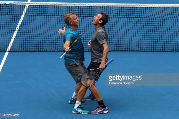 Thomas Johansson of Sweden and Mats Wilander of Sweden celebrates winning a point in their legend's match against John McEnroe of the United States...
