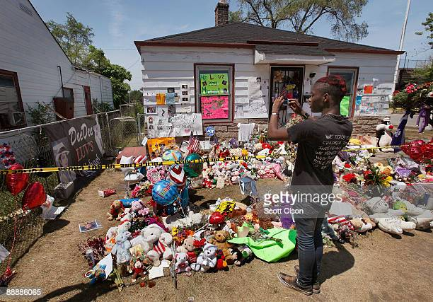 Thomas Johnson takes a picture outside the boyhood home of Michael Jackson July 7 2009 in Gary Indiana A memorial service was held today in Los...