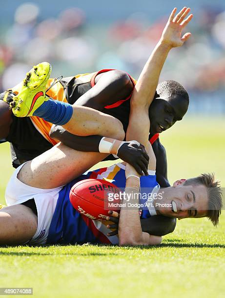 Thomas Jok of the Stingrays tackles Jordan Gallucci of the Ranges during the TAC Cup Semi Final match between Dendenong Stingrays and Eastern Ranges...