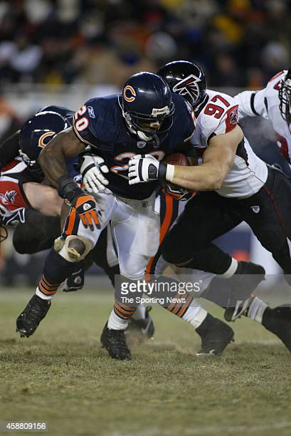 Thomas Jones of the Chicago Bears gets tackled by Patrick Kerney of the Atlanta Falcons during a game on December 18 2005 at Soldier Field Stadium in...