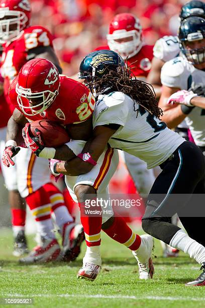 Thomas Jones of the Kansas City Chiefs is tackled by Rashean Mathis of the Jacksonville Jaguars on October 24, 2010 in Kansas City, Missouri. The...