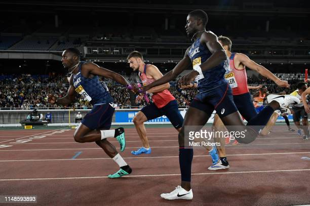 Thomas Jordier competes with Ludvy VAillant of France during the Men's 4x400m Relay FinalB on day two of the IAAF World Relays at Nissan Stadium on...