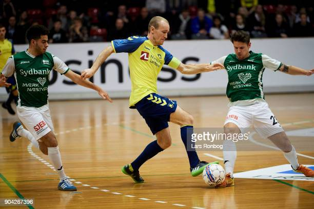 Thomas Kahlenberg of Brondby IFn and Andreas Baes of Nastved Boldklub compete for the ball during the indoor football tournament KMD Cup at Brondby...