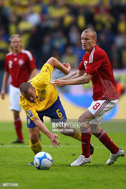 Thomas Kahlenberg of Denmark challenges Daniel Andersson of Sweden during the FIFA2010 World Cup Qualifying Group 1 match between Sweden and Denmark...