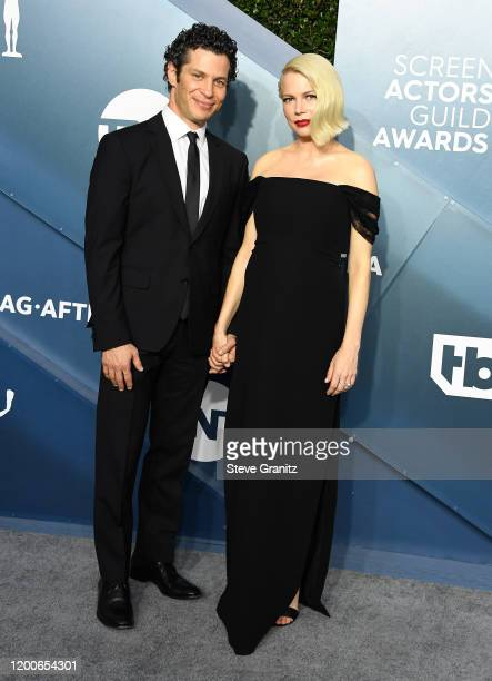 Thomas Kail and Michelle Williams arrives at the 26th Annual Screen Actors Guild Awards at The Shrine Auditorium on January 19 2020 in Los Angeles...