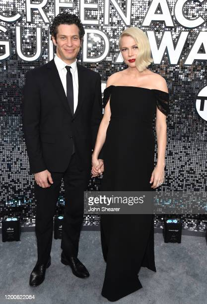 Thomas Kail and Michelle Williams attend the 26th Annual Screen Actors Guild Awards at The Shrine Auditorium on January 19 2020 in Los Angeles...