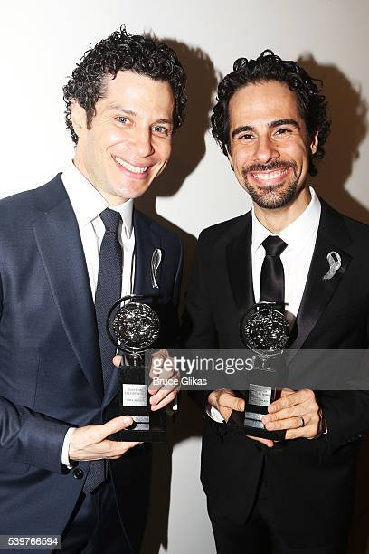 Thomas Kail poses with his award for Best Direction of a Musical and Alex Lacamoire poses with his award for Best Orchestrations at the 70th Annual...