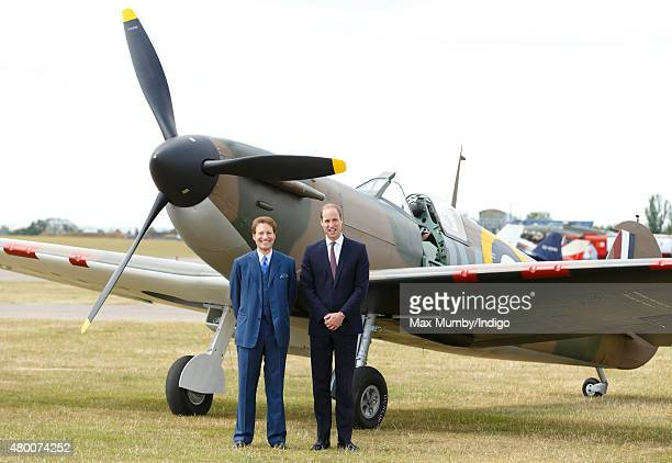 Thomas Kaplan and Prince William Duke of Cambridge pose for photographs in front of a newly restored Supermarine Spitfire Mark I aircraft donated to...