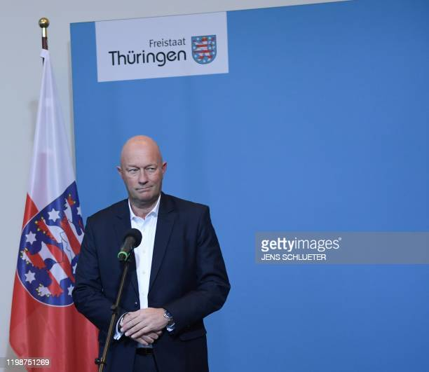 Thomas Kemmerich leader of the state branch of Thuringia's Free Democratic Party and newly elected Prime Minister of Thuringia reacts as he speaks to...