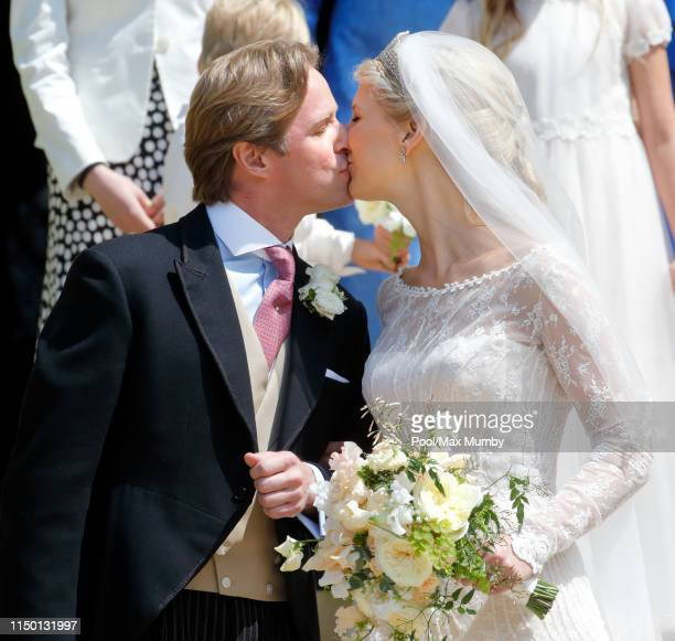 Thomas Kingston and Lady Gabriella Windsor kiss as they leave St George's Chapel after their wedding on May 18, 2019 in Windsor, England.