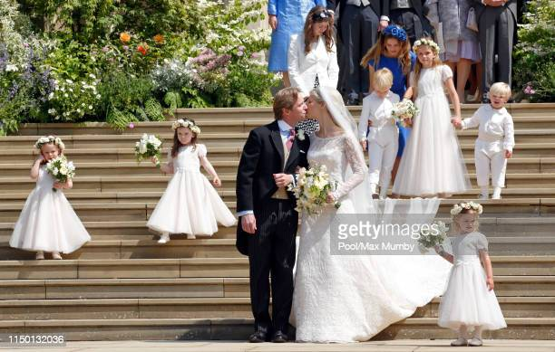 Thomas Kingston and Lady Gabriella Windsor kiss as they leave St George's Chapel after their wedding on May 18 2019 in Windsor England