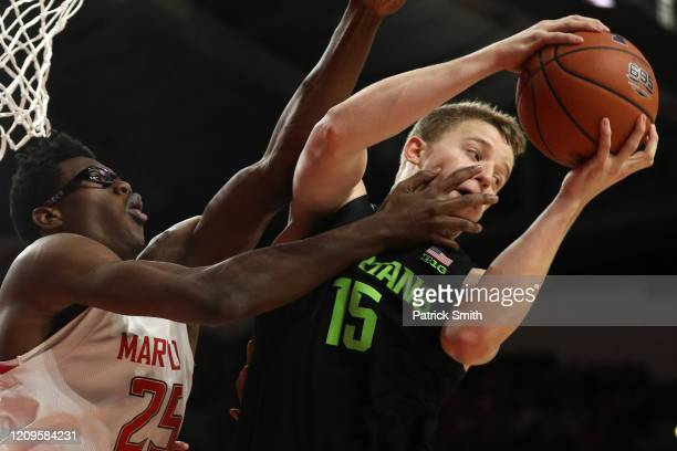 Thomas Kithier of the Michigan State Spartans pulls in a rebound in front of Jalen Smith of the Maryland Terrapins during the second half at Xfinity...