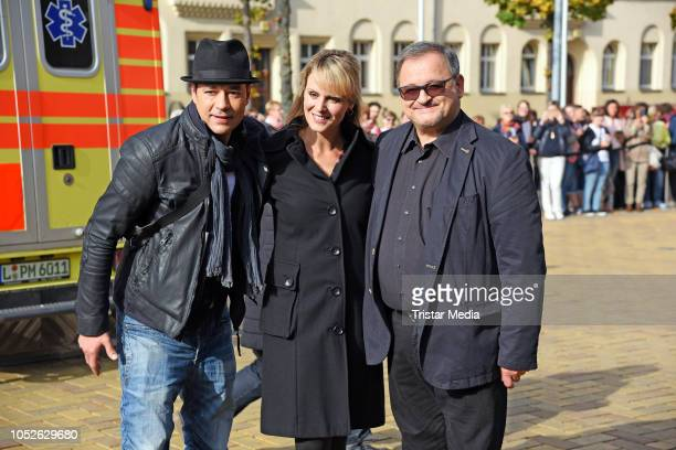 Thomas Koch, Anja Nejarri and Michael Trischan attend the ARD TV series 'In aller Freundschaft' 20 years anniversary fanfest at Media City on October...