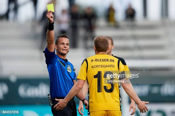 Thomas Kortegaard of AC Horsens receives a yellow card from Morten Krogh during the Danish Alka Superliga match between AC Horsens and FC...