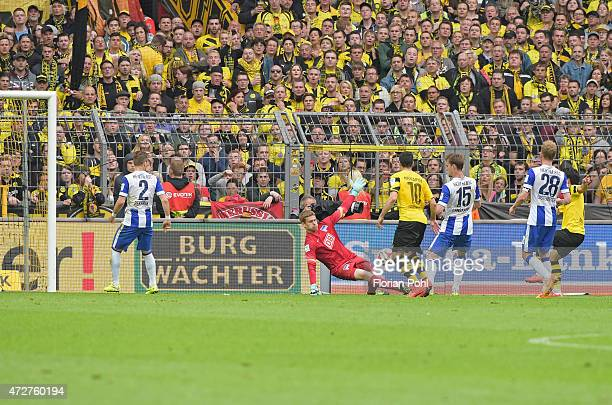 Thomas Kraft of Hertha BSC jumps to save goal the ball during the game between Borussia Dortmund and Hertha BSC on May 9 2015 in Dortmund Germany