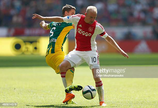 Thomas Kristensen of ADO Den Haag battles for the ball with Davy Klaassen of Ajax during the Dutch Eredivisie match between Ajax Amsterdam and ADO...