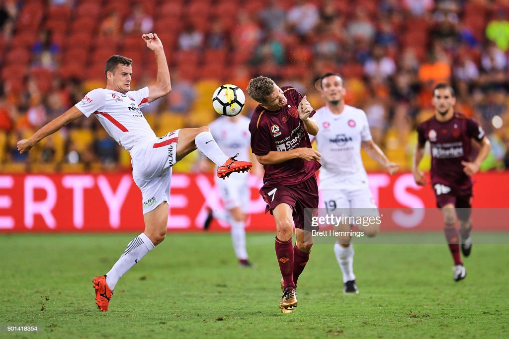 Thomas Kristensen of Brisbane and Oriol Riera of the Wanderers contest the ball during the round 14 A-League match between the Brisbane Roar and the Western Sydney Wanderers at Suncorp Stadium on January 5, 2018 in Brisbane, Australia.