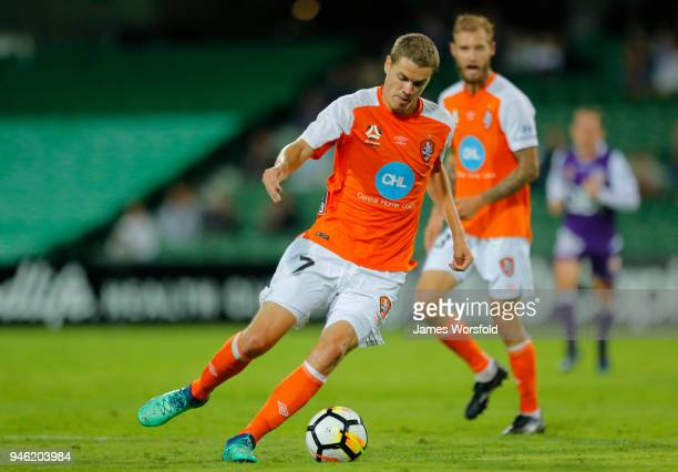 Thomas Kristensen of the Brisbane Roar takes control of the ball inside the defensive half during the round 27 ALeague match between the Perth Glory...