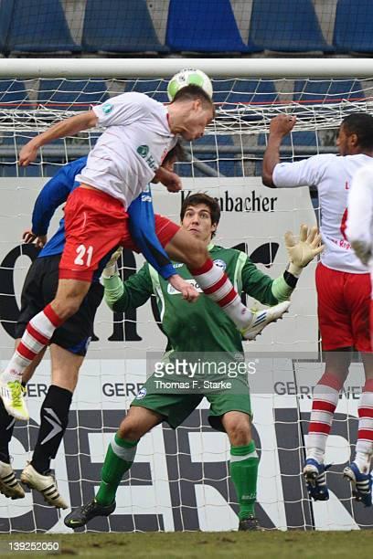 Thomas Kurz of Regensburg scores against goalkeeper Stefan Ortega of Bielefeld during the Third League match between Arminia Bielefeld and Jahn...