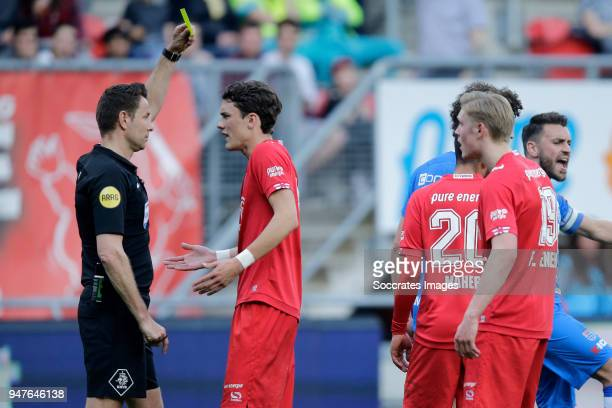 Thomas Lam of FC Twente receives a yellow card from referee Pol van Boekel during the Dutch Eredivisie match between Fc Twente v PEC Zwolle at the De...