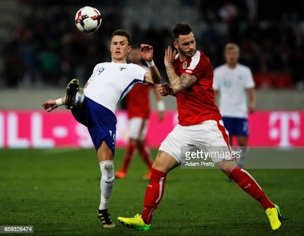 Thomas Lam of Finland is challenged by Marko Arnautovic of Austria during the Austria v Finland International Friendly match at Tivoli Stadium on...