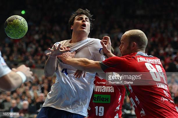 Thomas Lammers of AhlenHamm tackles Domagoj Duvnjak of Hamburg during the Toyota Handball Bundesliga match between HSG AhlenHamm and HSV Hamburg at...