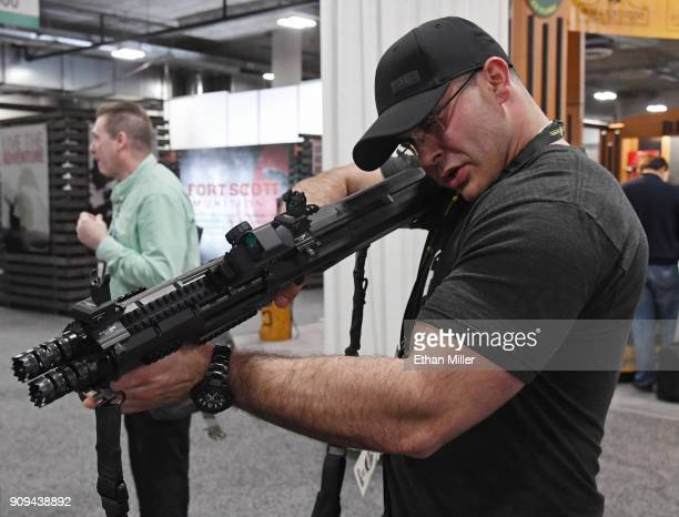 Thomas Larosa of Texas looks at a Standard Manufacturing Co DP12 double pumpaction shotgun at the 2018 National Shooting Sports Foundation's Shooting...
