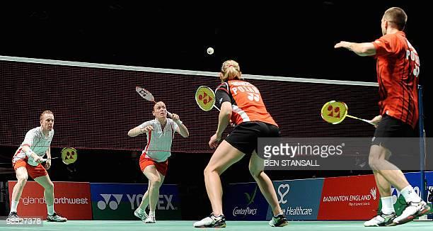 Thomas Laybourn and Kamilla Rytter Juhl of Denmark return a shot to Nadiezda Kostiuczyk and Robert Mateusiak of Poland during their final mixed...