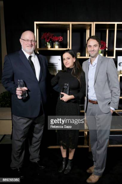 Thomas Lee Wright Laura Checkoway and Tim Horsburgh pose with the Best Short award at the 33rd Annual IDA Documentary Awards at Paramount Theatre on...