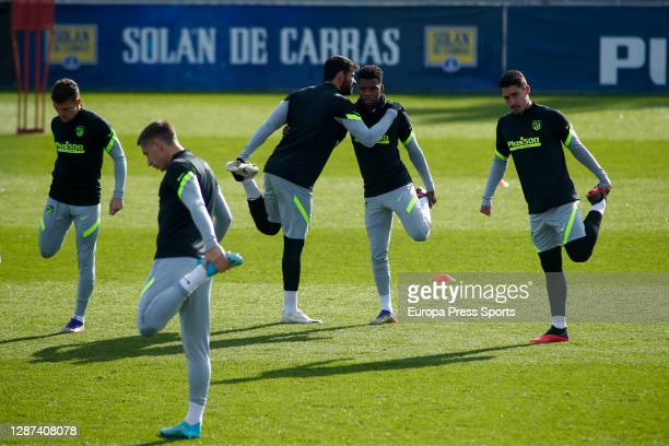 Thomas Lemar and Diego Costa warm up during the Atletico de Madrid training session for the UEFA CHampions League football match to play against...