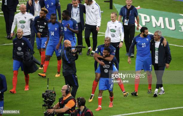 Thomas Lemar and Djibril Sidibe of France celebrate the qualification with teammattes the FIFA 2018 World Cup Qualifier between France and...