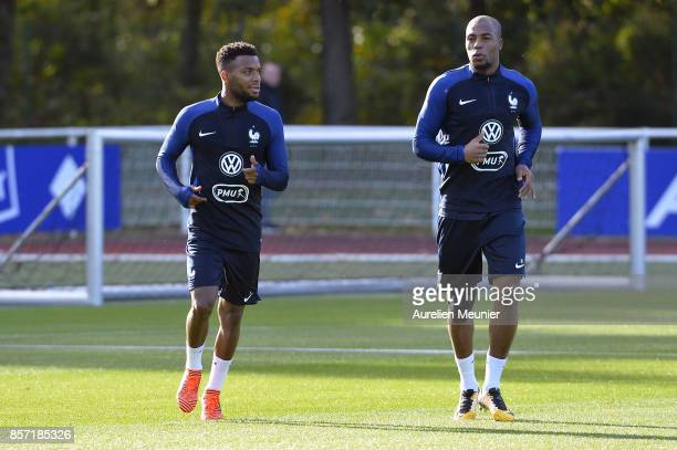 Thomas Lemar and Djibril Sidibe of France warmup during a France training session on October 3 2017 in Clairefontaine France